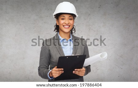 building, developing, construction and architecture concept - smiling businesswoman in white helmet with clipboard and blueprint