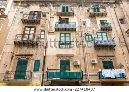 Building exterior with windows and balconies in Palermo, Italy