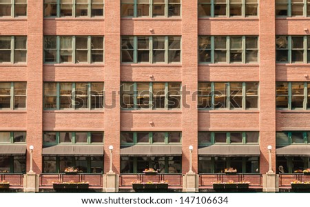 Building exterior with windows of a commercial office building in downtown  Chicago - stock photo