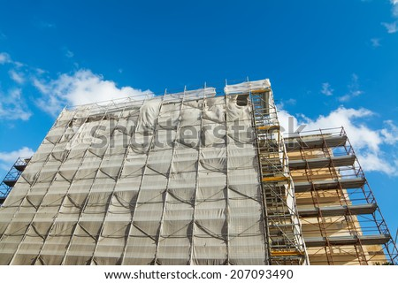 building facade covered for restoration work - stock photo