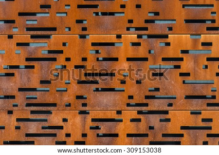 building facade made of perforated weathering steel sheets corten steel