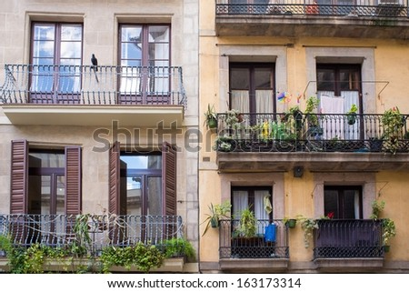 Building facade with beautiful balconies  - stock photo