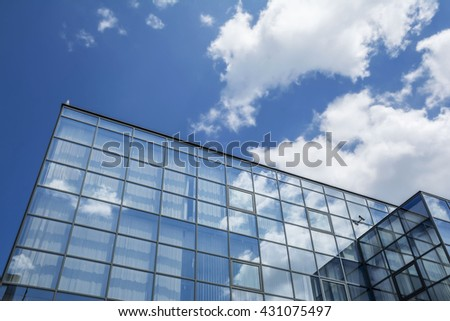 Building facade with blue sky and white clouds