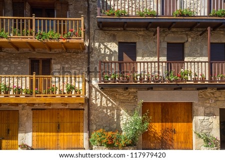Building facade with lot of flower pots - stock photo