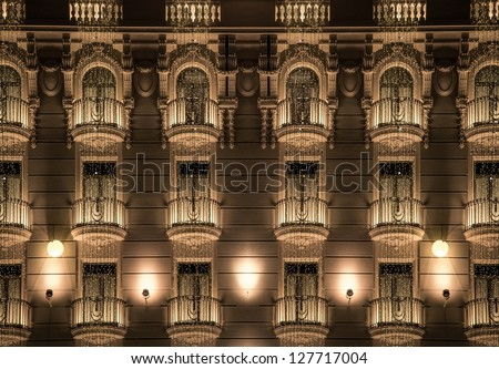 Building facade with shiny decorations - stock photo