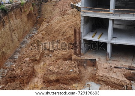 building foundation pit.frame of a house under construction