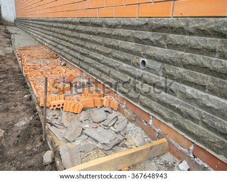 Building Foundation Waterproofing. Building New House. New Construction  Waterproofing Basement Walls From Outside With