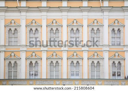 building front wall with repeting pattern of windows. moscow, russia - stock photo