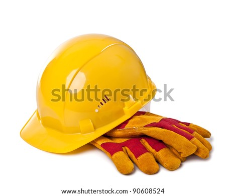 Building helmet and protective gloves on the isolated white background - stock photo