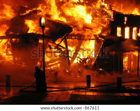 Building in a inferno of flames (some noise) - stock photo