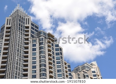 Building in cloudy day - stock photo