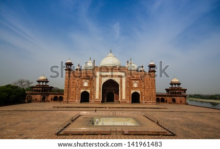 building in side of the taj mahal with blue sky