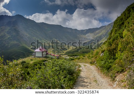 Building in the mountain valley - weather station in the Rodna Mountains, The Carpathians, Romania - stock photo