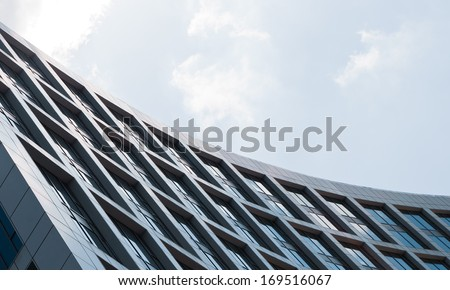 Building made of steel and glass in front of the sky
