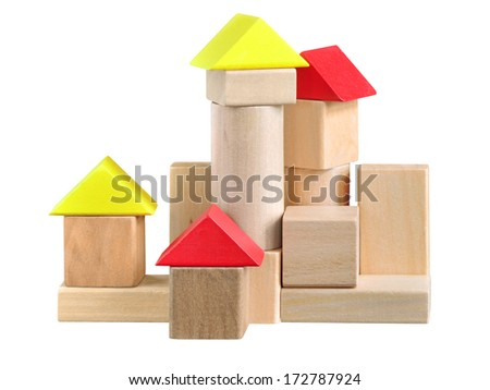 Building made of wooden blocks toy. Isolated with path on white. - stock photo