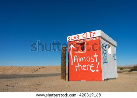 building marking the entry to slab city california - stock photo