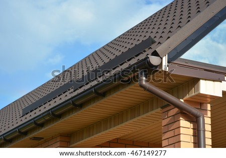 Building Modern House Construction With Metal Roof Corner, Rain Gutter  System And Roof Protection From