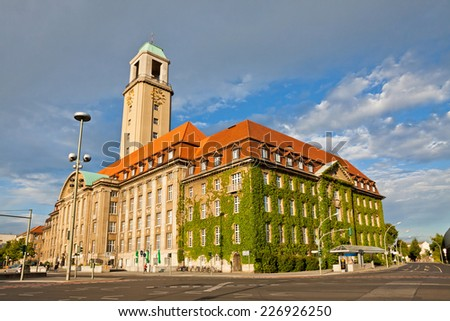 Building of Berlin-Spandau Town Hall (Rathaus Spandau), Germany. It is the town hall of the borough of Spandau in the western suburbs of Berlin - stock photo