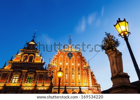 building of the brotherhood of blackheads in the UNESCO protected old town of Riga at night - stock photo