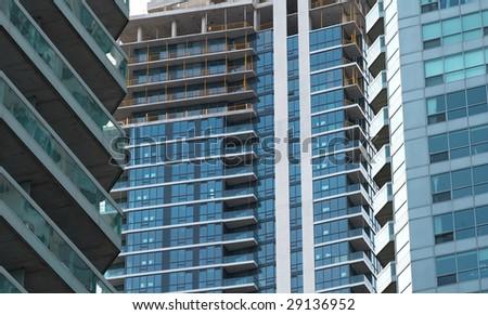 Building of the condo block is in progress - stock photo