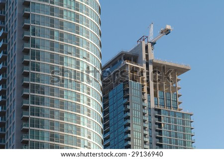 Building of the condo is in progress - stock photo