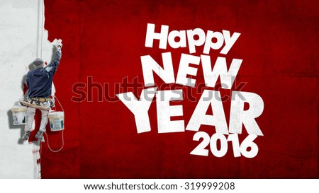 Building painter hanging from harness painting a wall with the words Happy New Year 2016 - stock photo