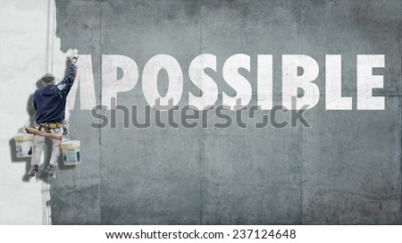 Building painter overwriting the beginning of the word impossible so that it becomes possible  - stock photo