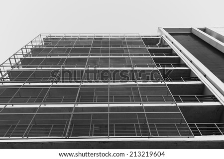 building parking garage and white sky,  black and white - stock photo