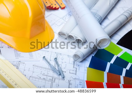 Building plans and paints - stock photo