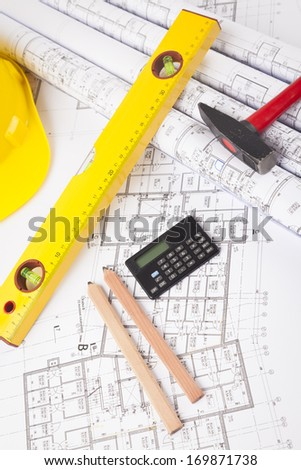 building plans under construction - stock photo