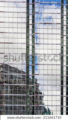 Building reflection on glass steel facade  - stock photo