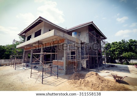 building residential construction house with scaffold steel for construction worker, image used vintage filter - stock photo