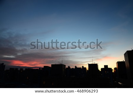 Building silhouette against sunset sky