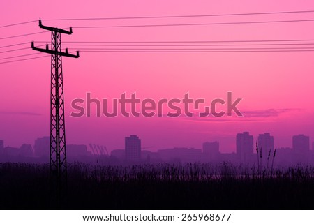 Building silhouettes in purple cloudy sunset background, dark photo, dramatic sunset, city scene on sunset, Vilnius, Lithuania