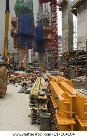Building Site and Construction Materials with Large Tower Cranes - stock photo