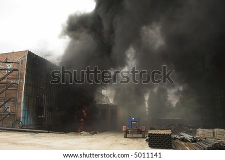 Building site with a lot of black smoke