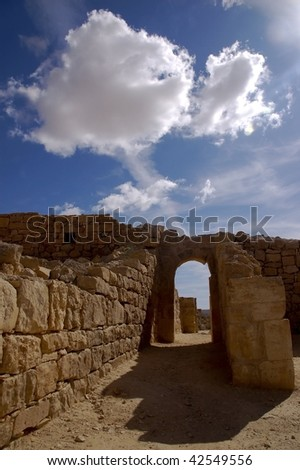 building stone gate on blue sky and clouds
