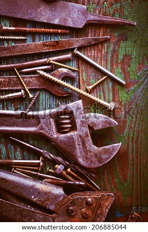 Building tools over wooden background
