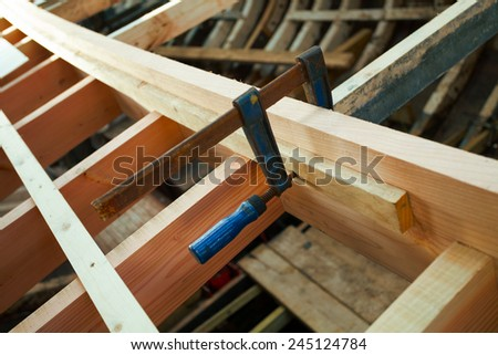 Building Traditional Wooden boat. Detail. Shallow DOF - stock photo
