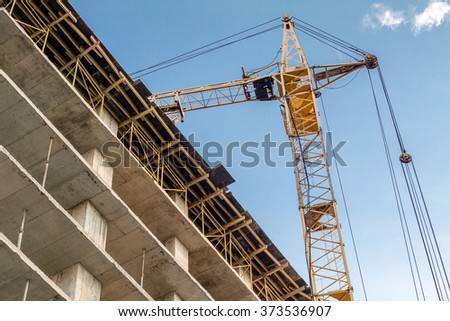 Building under construction and crane.