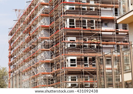 building under construction with scaffolding set
