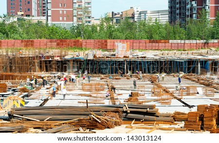 building under construction with workers - stock photo