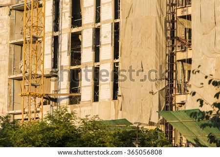 building under debris netting at construction site. - stock photo