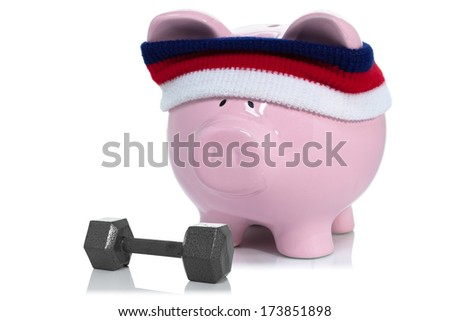 Building up savings account, piggy bank working out - stock photo