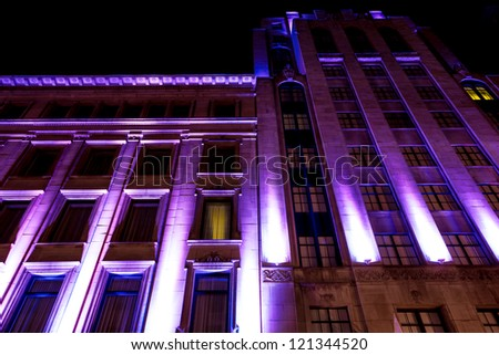 Building Windows illuminated in purple color in Montreal. - stock photo