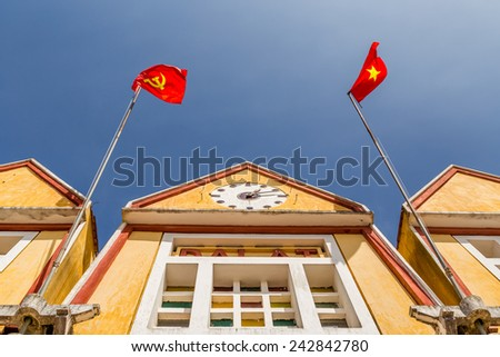 Building with a clock and communist flags - stock photo