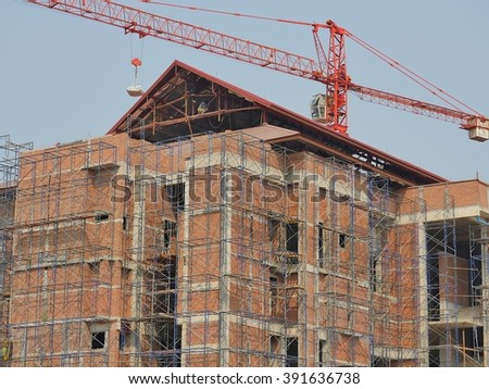 Building with crane at Construction site