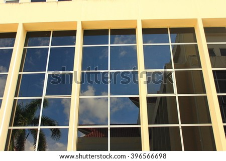 building with lots of reflective glass around - stock photo