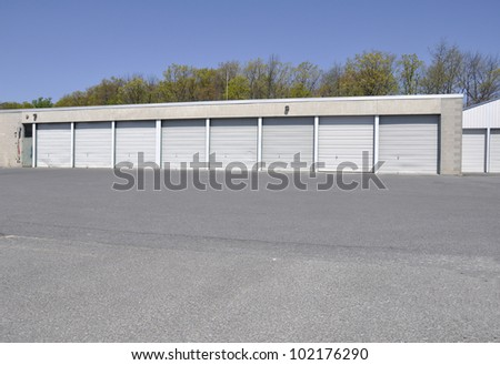 building with many garage doors, which are all closed; - stock photo