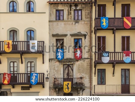 Building with medieval shields at the Piazza Grande in Arezzo, Italy - stock photo